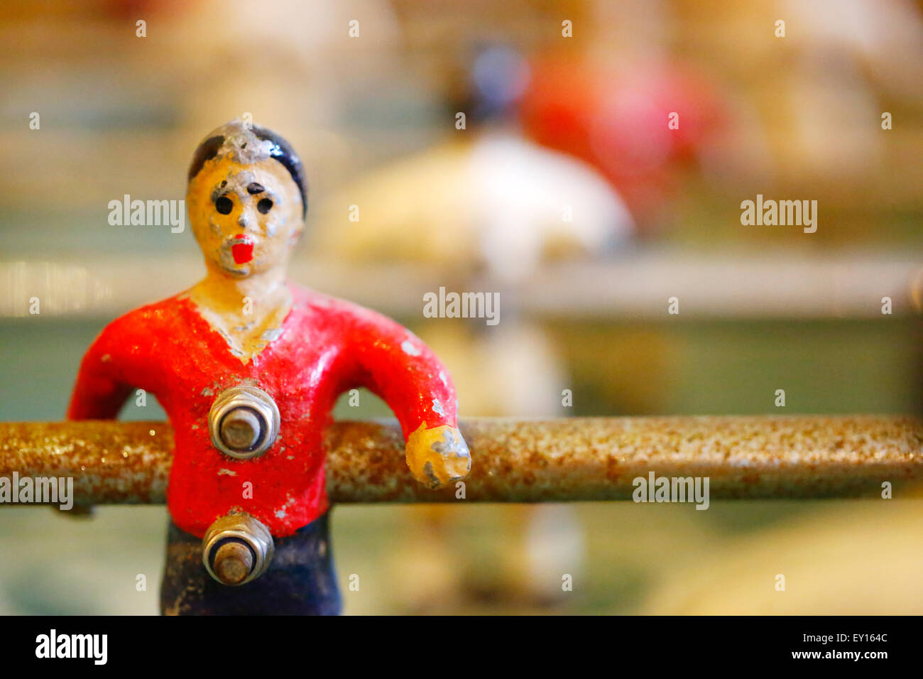 A old table top football player close up. Known as Foosball or babyfoot it's a much loved well worn player who's - Stock Image