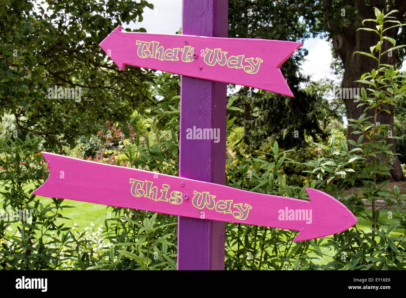 A fun and confusing sign of this way and that way - take your pick! - Stock Image