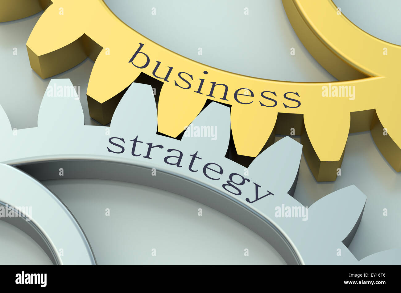 Business and Strategy concept on metallic gearwheel - Stock Image