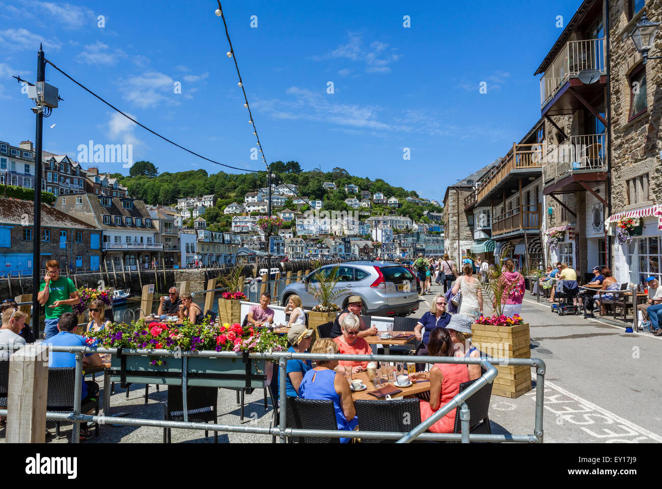 The Old Boathouse Pub on the Quay in East Looe looking over the river to West Looe, Cornwall, England, UK - Stock Image