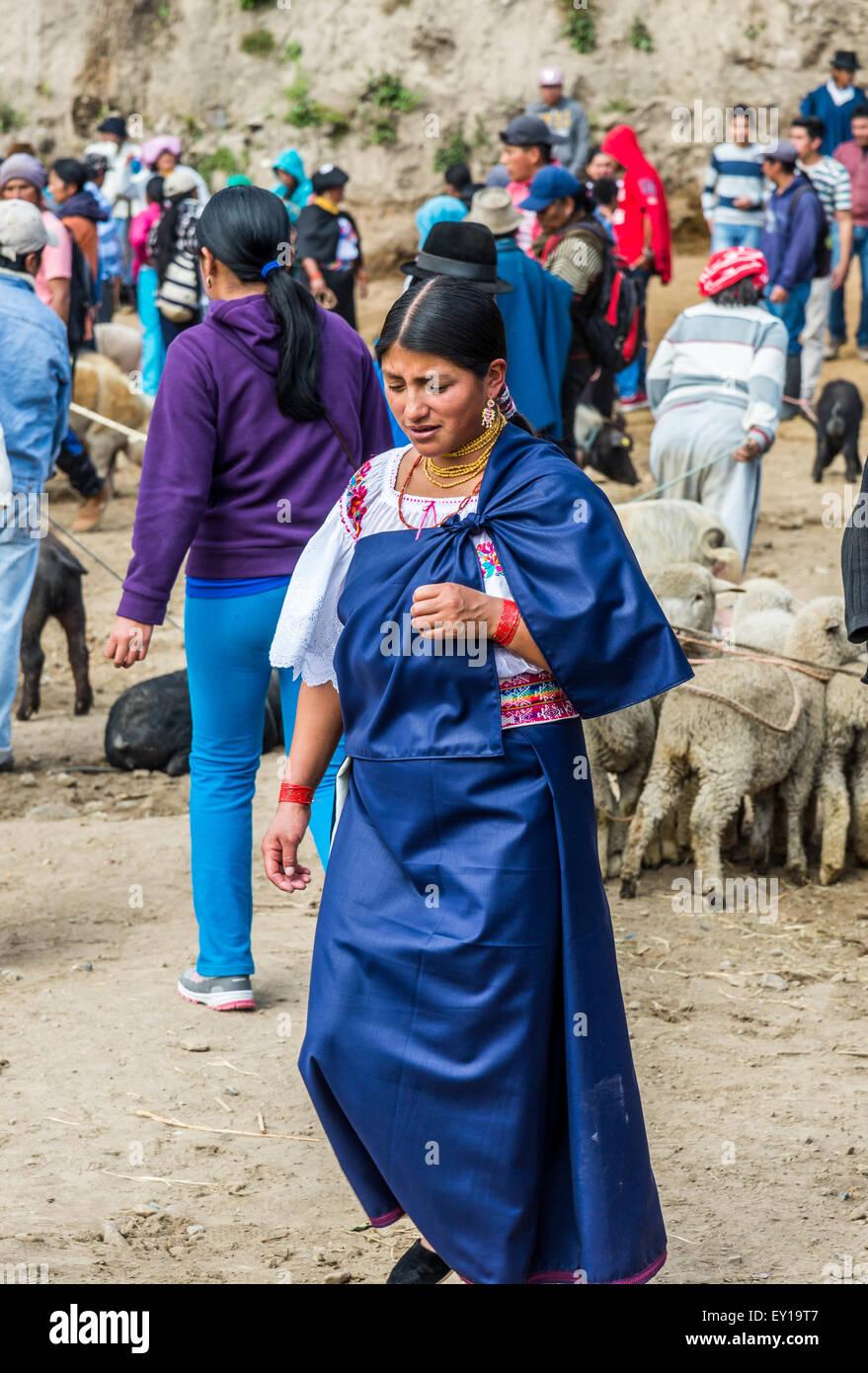 A native woman in traditional dress at livestock market. Otavalo, Ecuador. - Stock Image