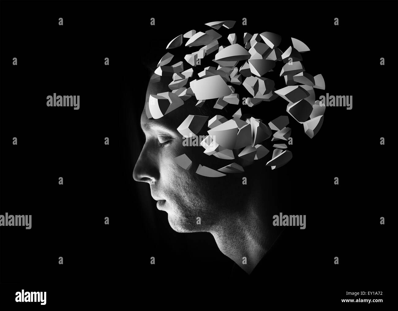 Male head profile with 3d explosion brain fragments on black background - Stock Image