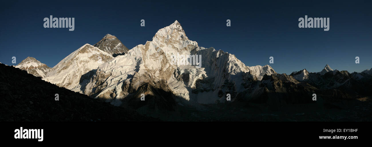 Sunset over Mount Everest (8,848 m) and Mount Nuptse (7,861 m) in Khumbu region, Himalayas, Nepal. Panorama from - Stock Image