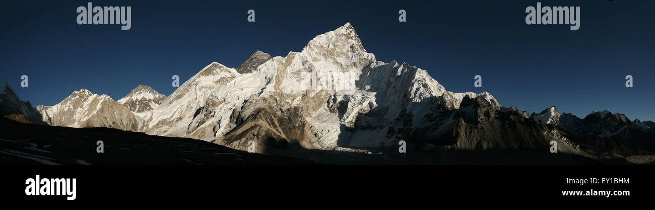Mount Everest (8,848 m) and Mount Nuptse (7,861 m) in Khumbu region, Himalayas, Nepal. Panorama from the point on - Stock Image