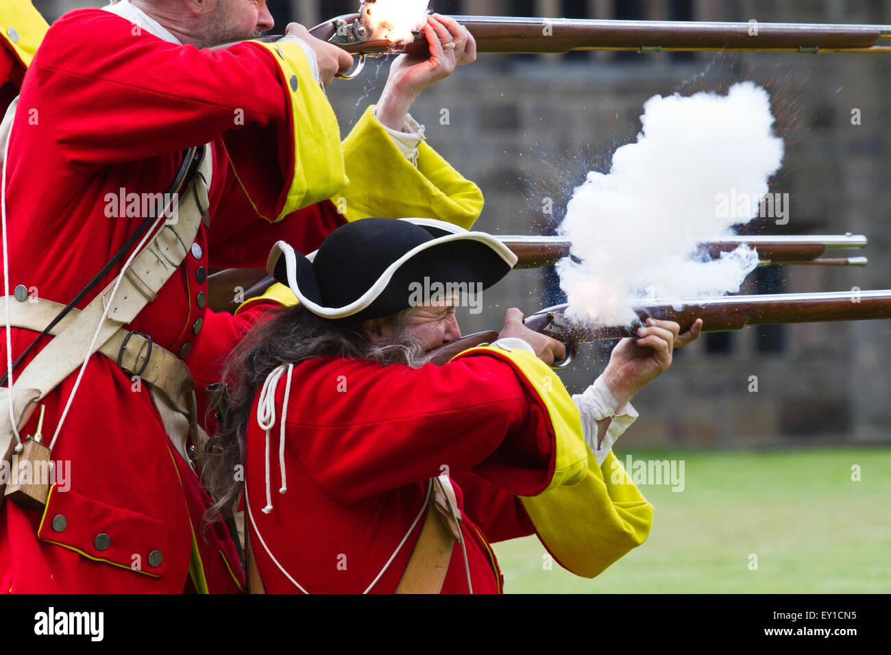 redcoat Jacobite rebellion weapon weapons gun guns firing tricorn hats brims reenactor reenactors reenactment uniform Stock Photo