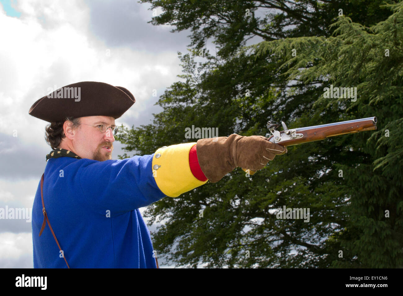 redcoat Jacobite rebellion weapon weapons gun guns firing tricorn hats brims reenactor reenactors reenactment uniform Stock Photo