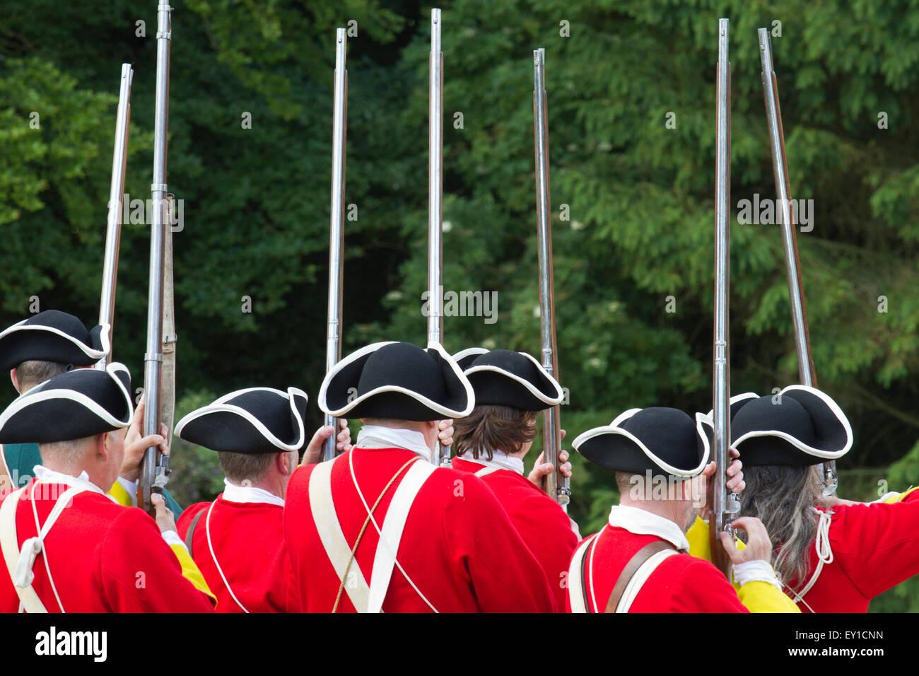 Hoghton Towers, Chorley, Lancashire, UK. 19th July, 2015.  English redcoat musketeers firing guns at the re-enactment Stock Photo