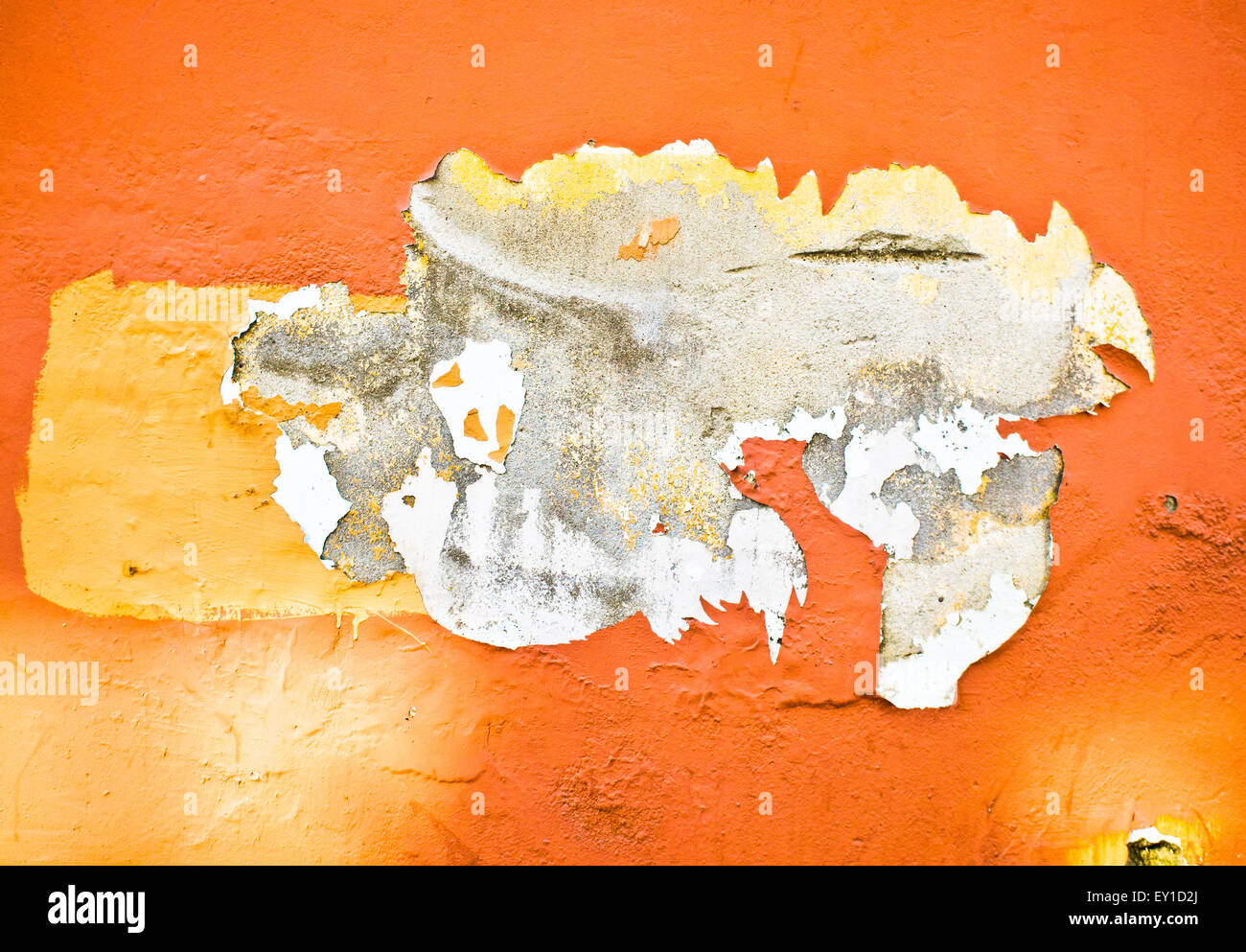 Peeling orange paint on a stone wall, as a background Stock Photo