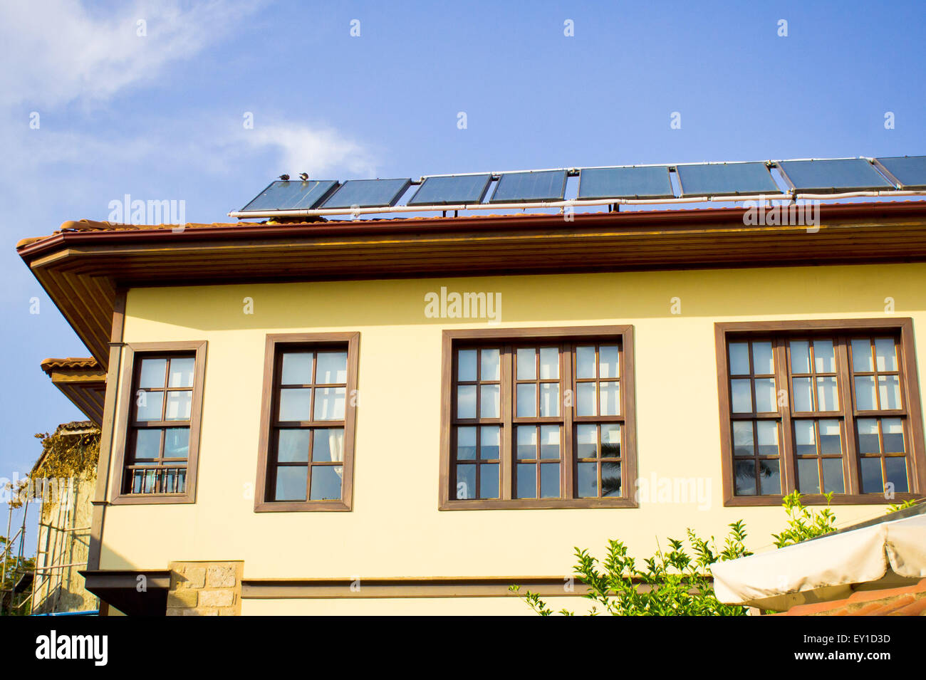 Modern solar panels on a traditional Ottoman style house in Turkey Stock Photo
