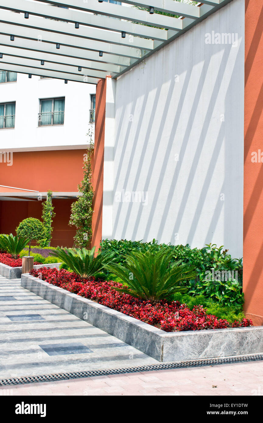 A colorful garden in the fgrounds of a modern building Stock Photo