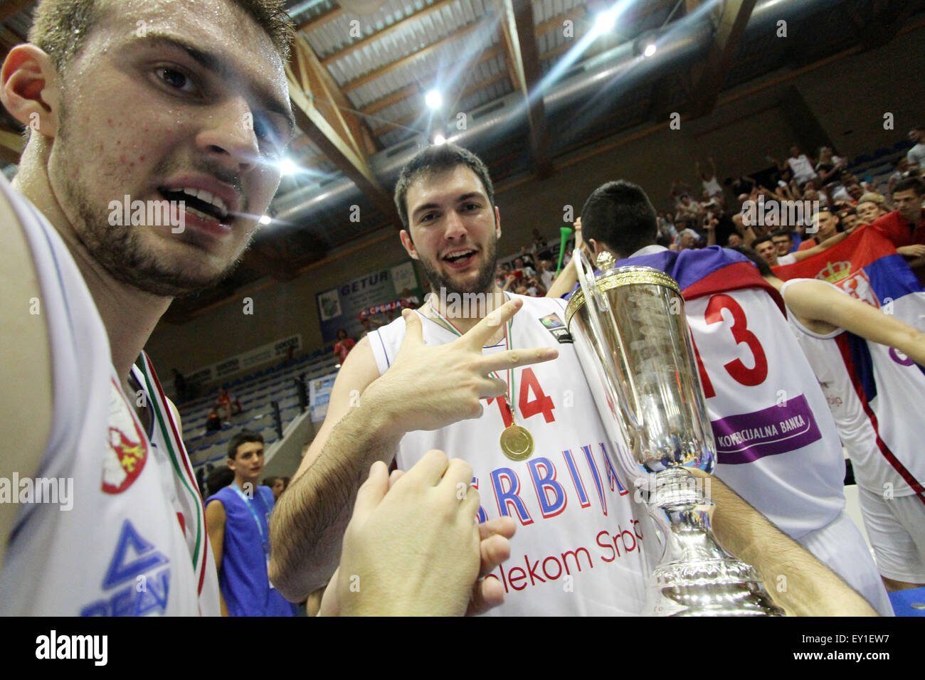 Lignano, Italy. 19th July, 2015. Serbia's Marko Guduric (L) and Serbia's Djoko Salic s their victory over - Stock Image
