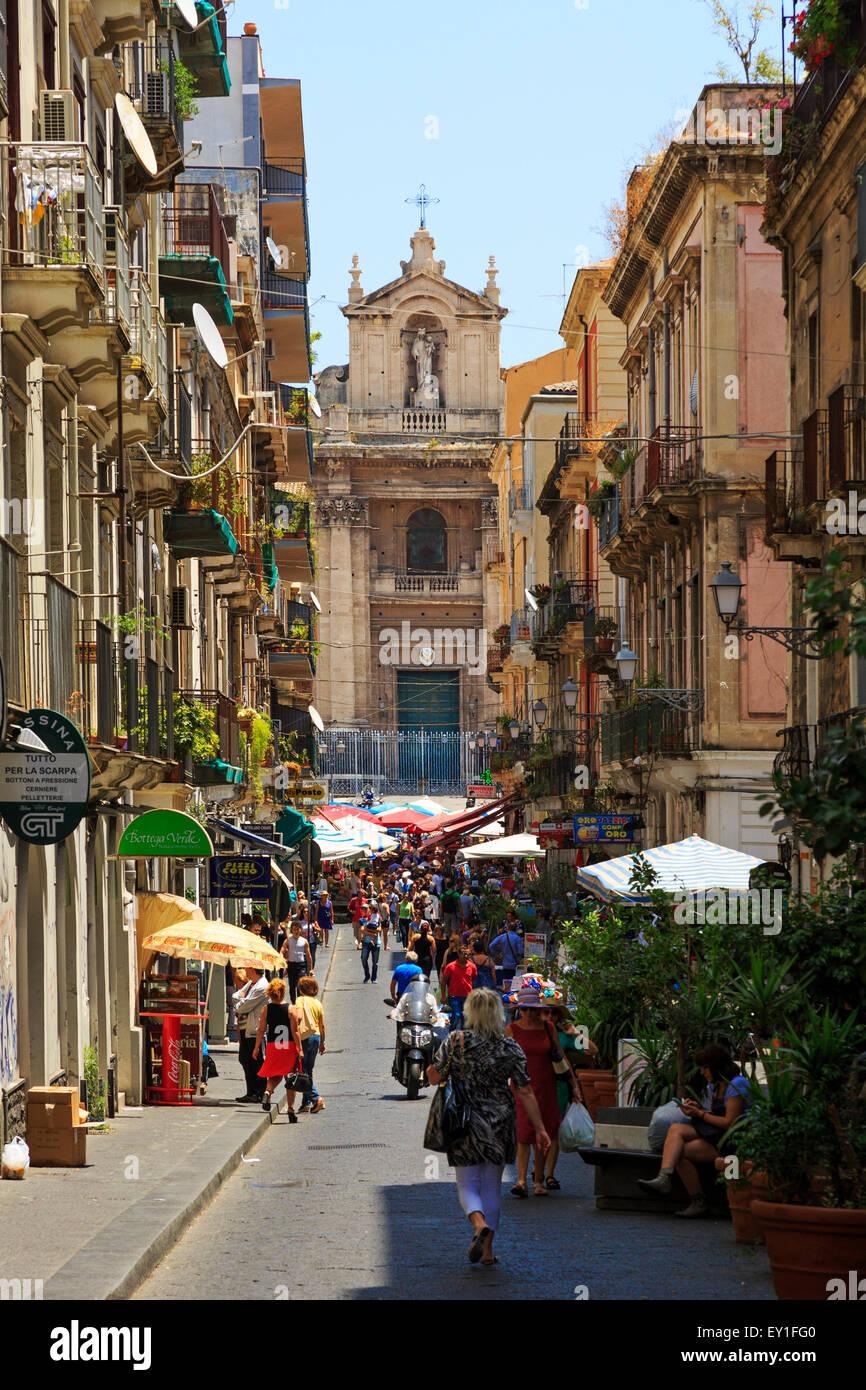 Via Pucini, Catania, Sicily with a view to the church of Santuario della Madonna del Carmine , over the street market - Stock Image