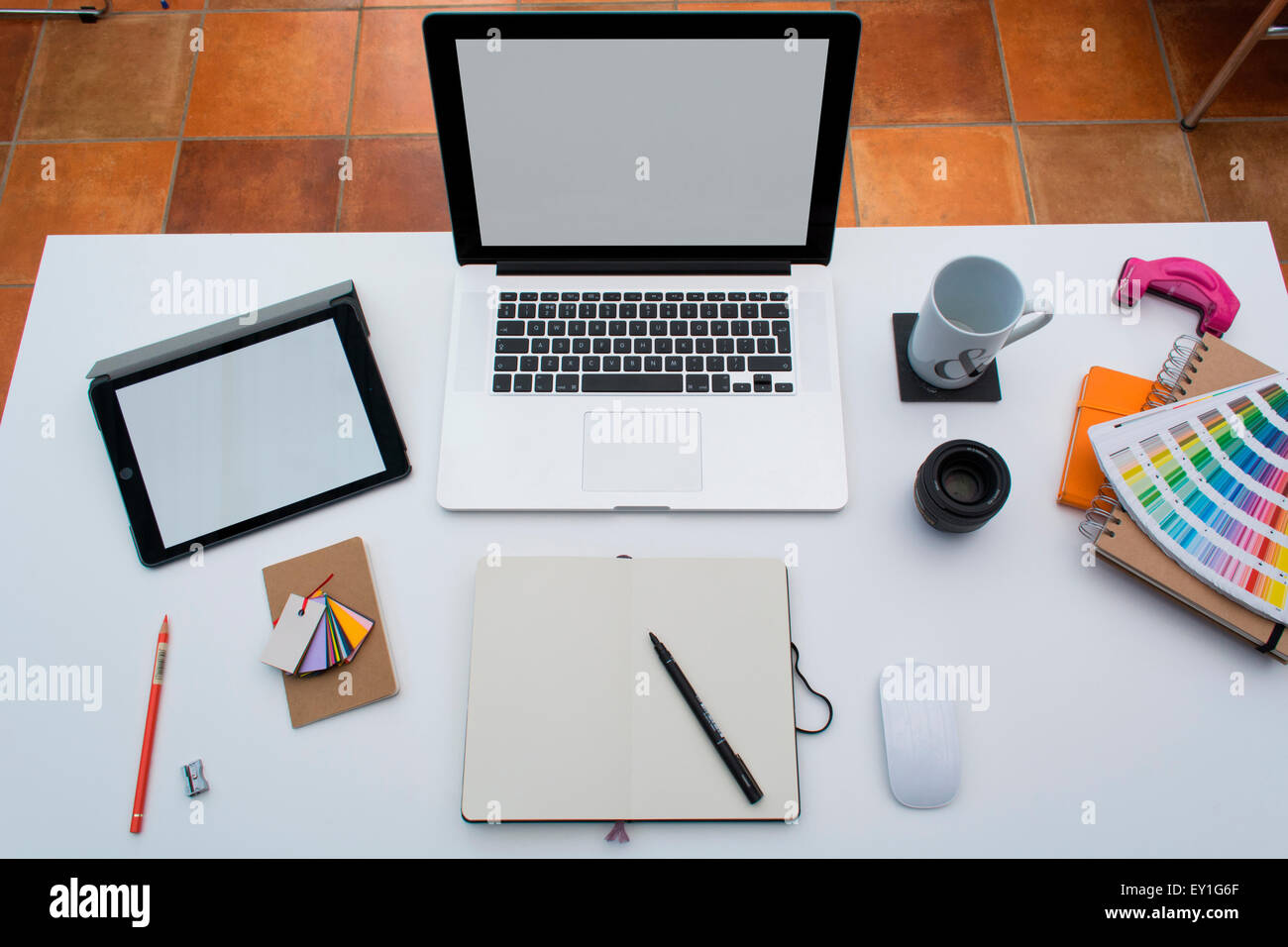 Creative Home Office space with graphic designers desk with laptop ...