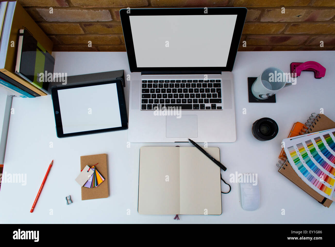 Office Graphic Design. Creative Home Office Space With Graphic Designers  Desk Laptop Against A Brick