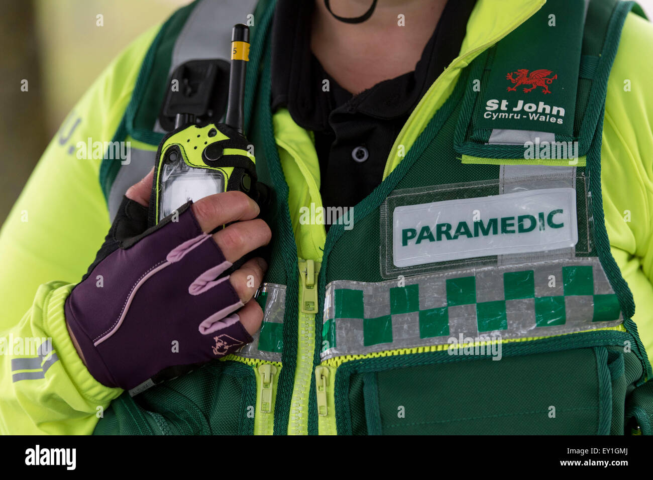 A closeup of a Welsh paramedic / ambulance worker. The Welsh ambulance service are under pressure to improve response - Stock Image