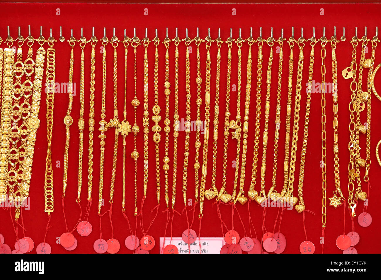 close up of Gold necklaces in store - Stock Image