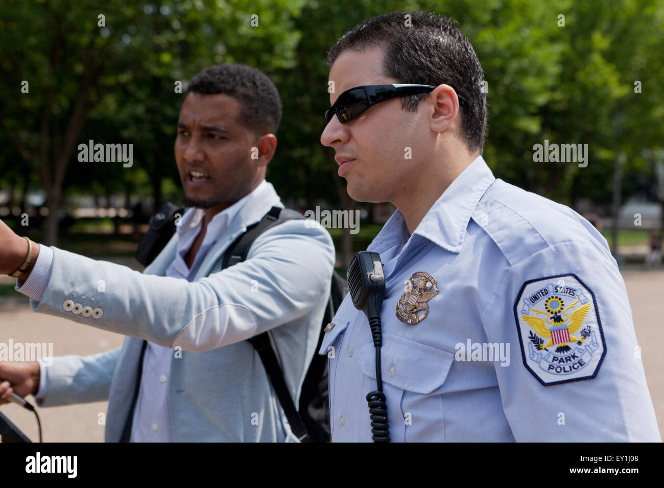 US Park Police officer talking with black civilian - Washington, DC USA - Stock Image
