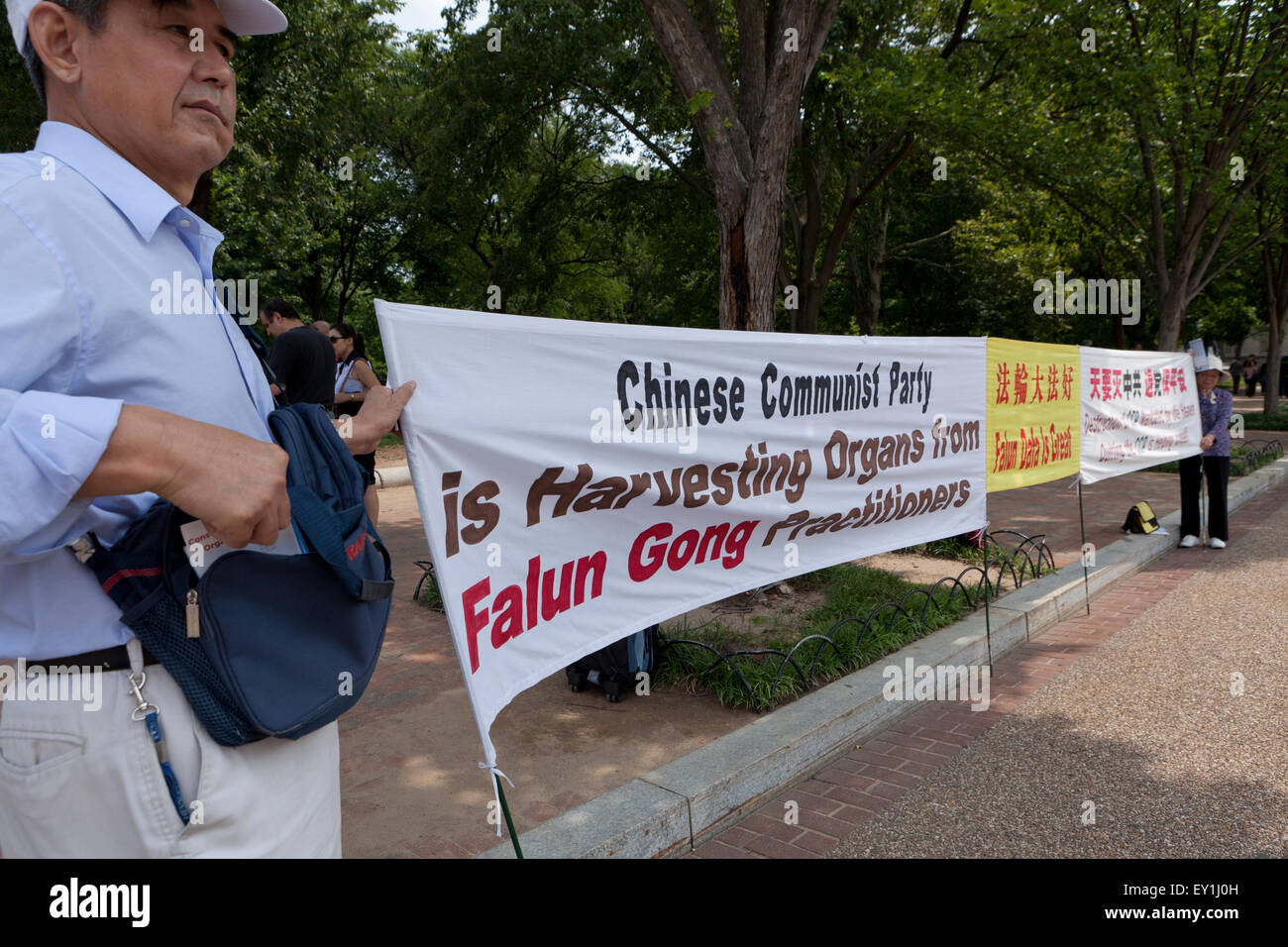 Falun Gong practitioners protesting against Chinese Communist party - Washington, DC USA - Stock Image