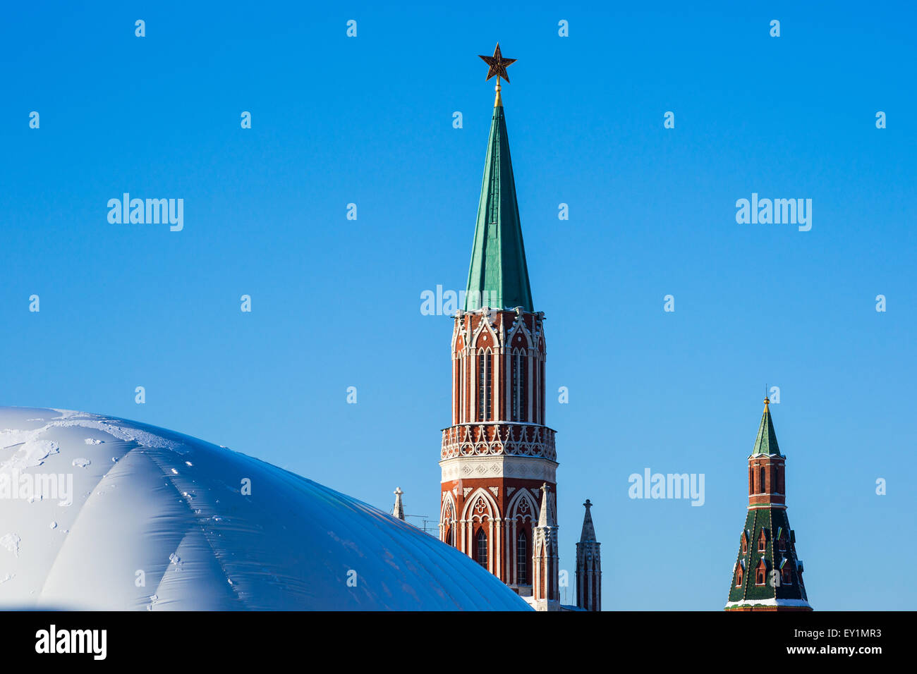 Nikolskaya tower of Moscow Kremlin and protection cover over Lenin's mausoleum which was under reconstruction - Stock Image
