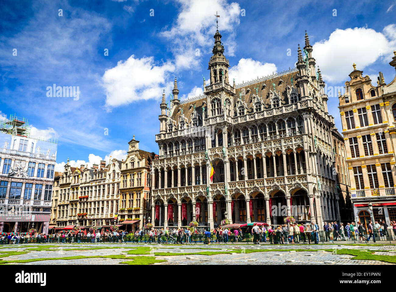 "Tourists in Grand Place, Maison du Roi, one of Europe finest historic squares and a ""must-see"" sight of Brussels, Stock Photo"