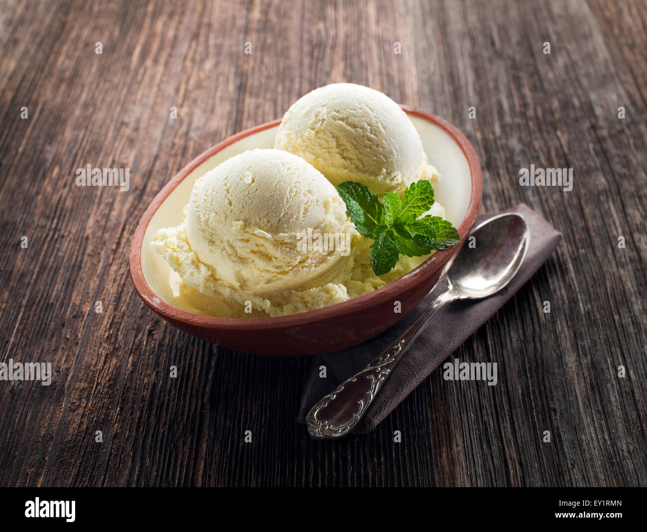 Vanilla Ice cream on a wooden background close up Stock Photo