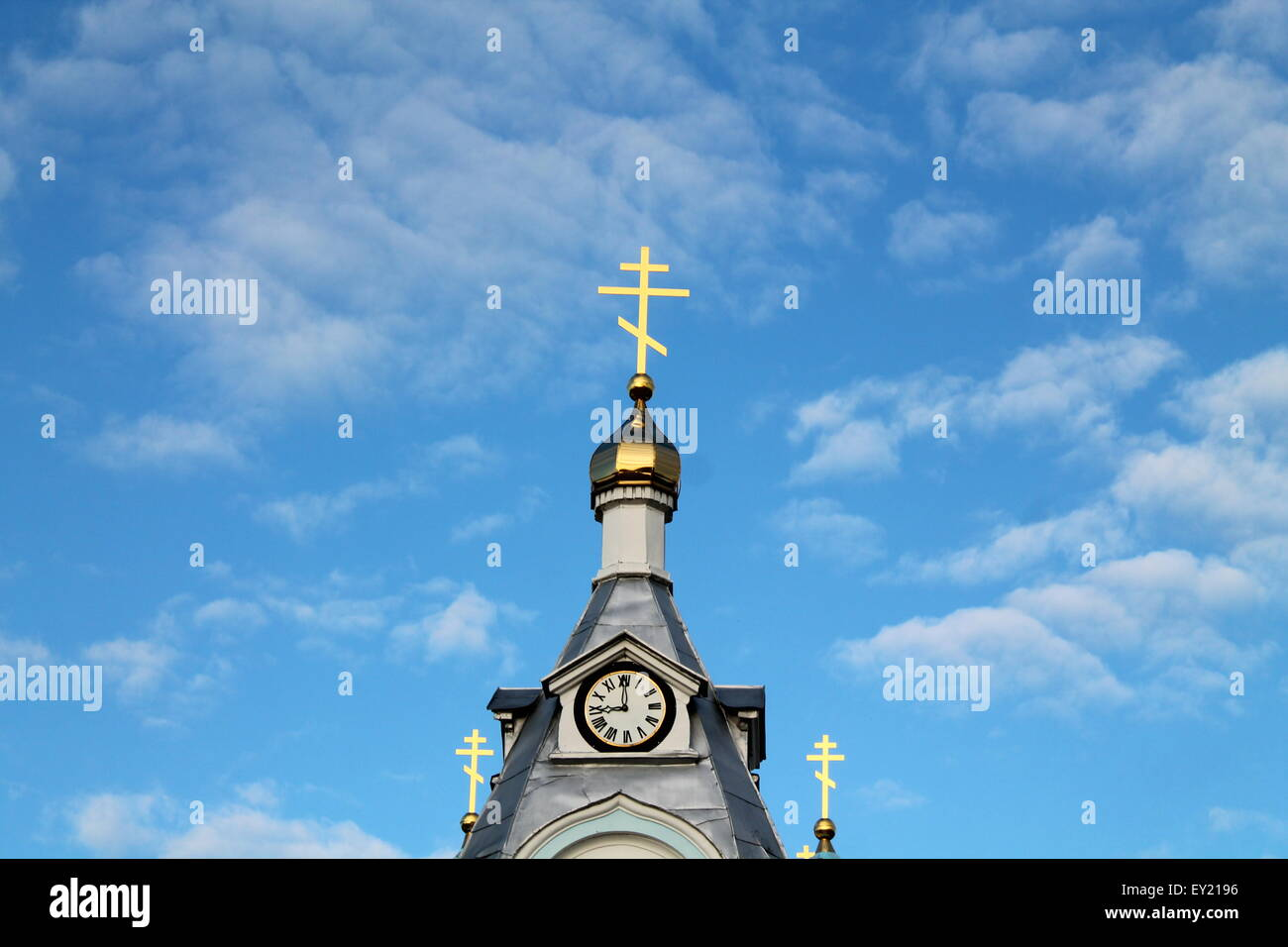 symbol of faith and believe shine crucifix on dome of orthodox church in blue sky Stock Photo