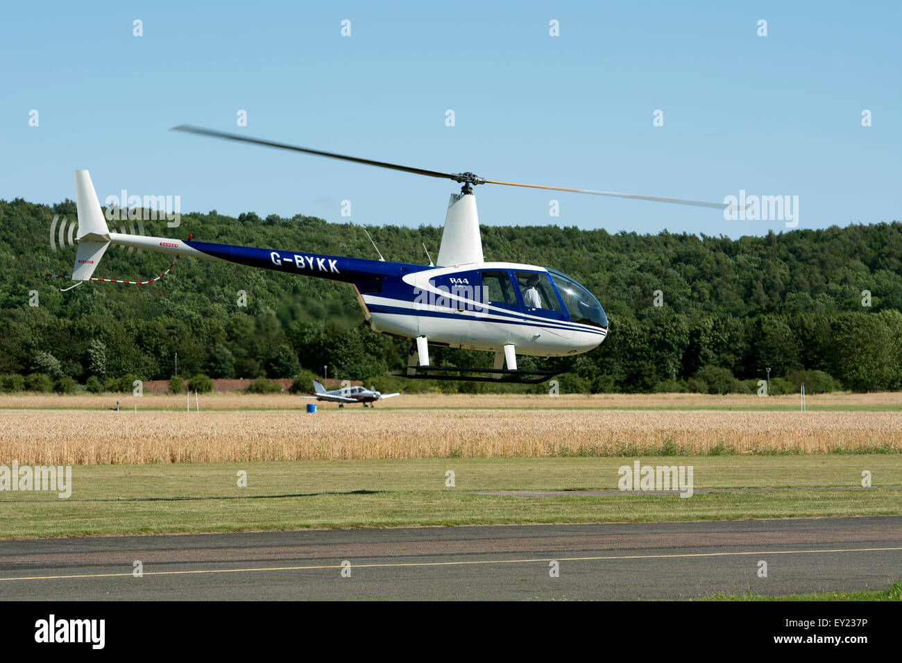 Robinson R44 Astro helicopter (G-BYKK) - Stock Image