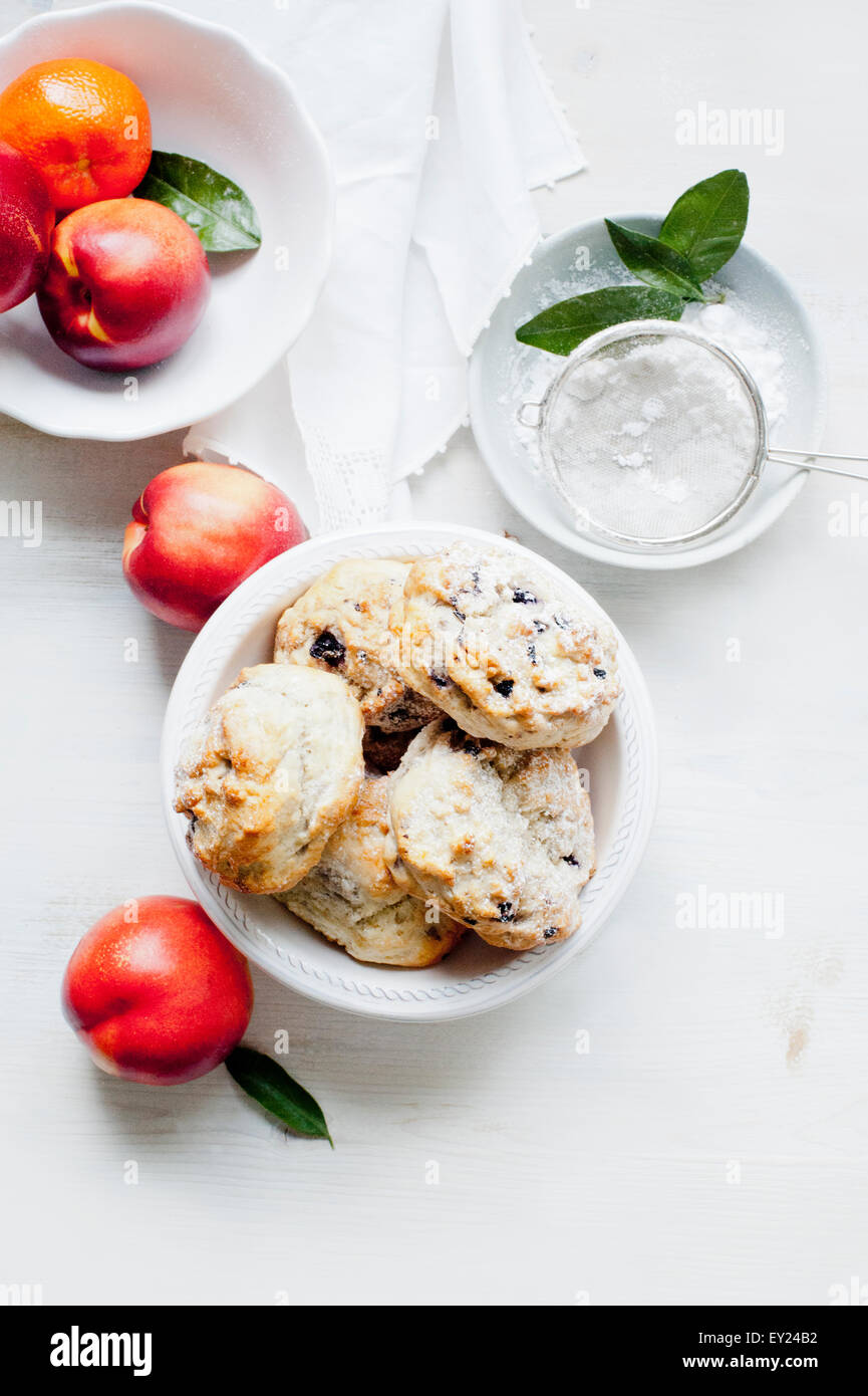 Blueberry scones served with caster sugar and fresh fruits - Stock Image