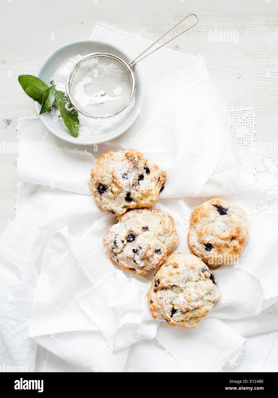 Still life of blueberry scones served with caster sugar - Stock Image