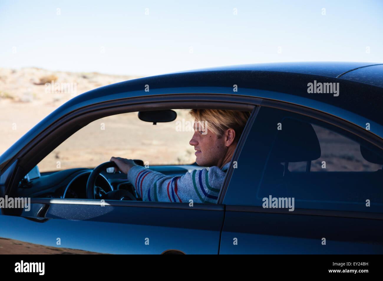 Man driving on road trip, Tuba City, Arizona, USA - Stock Image