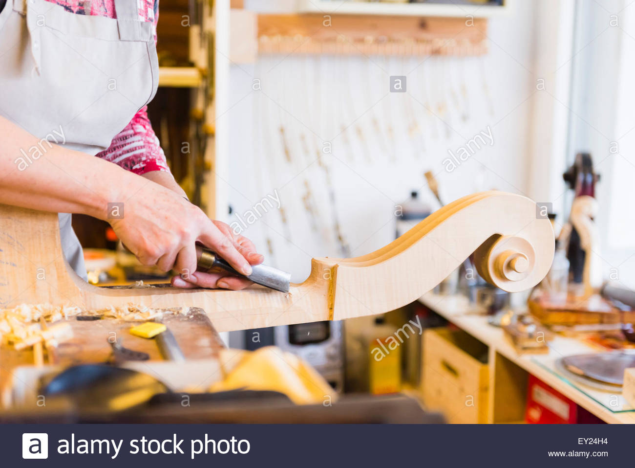 Violin maker making violins in production studio - Stock Image