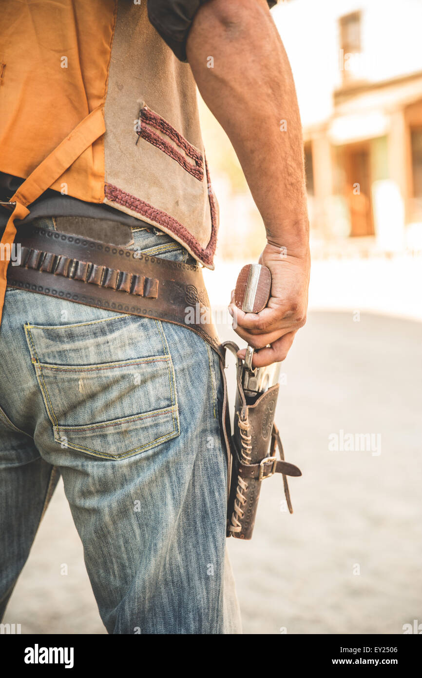 Cropped close up of cowboy holster and gun on wild west film set, Fort Bravo, Tabernas, Almeria, Spain - Stock Image