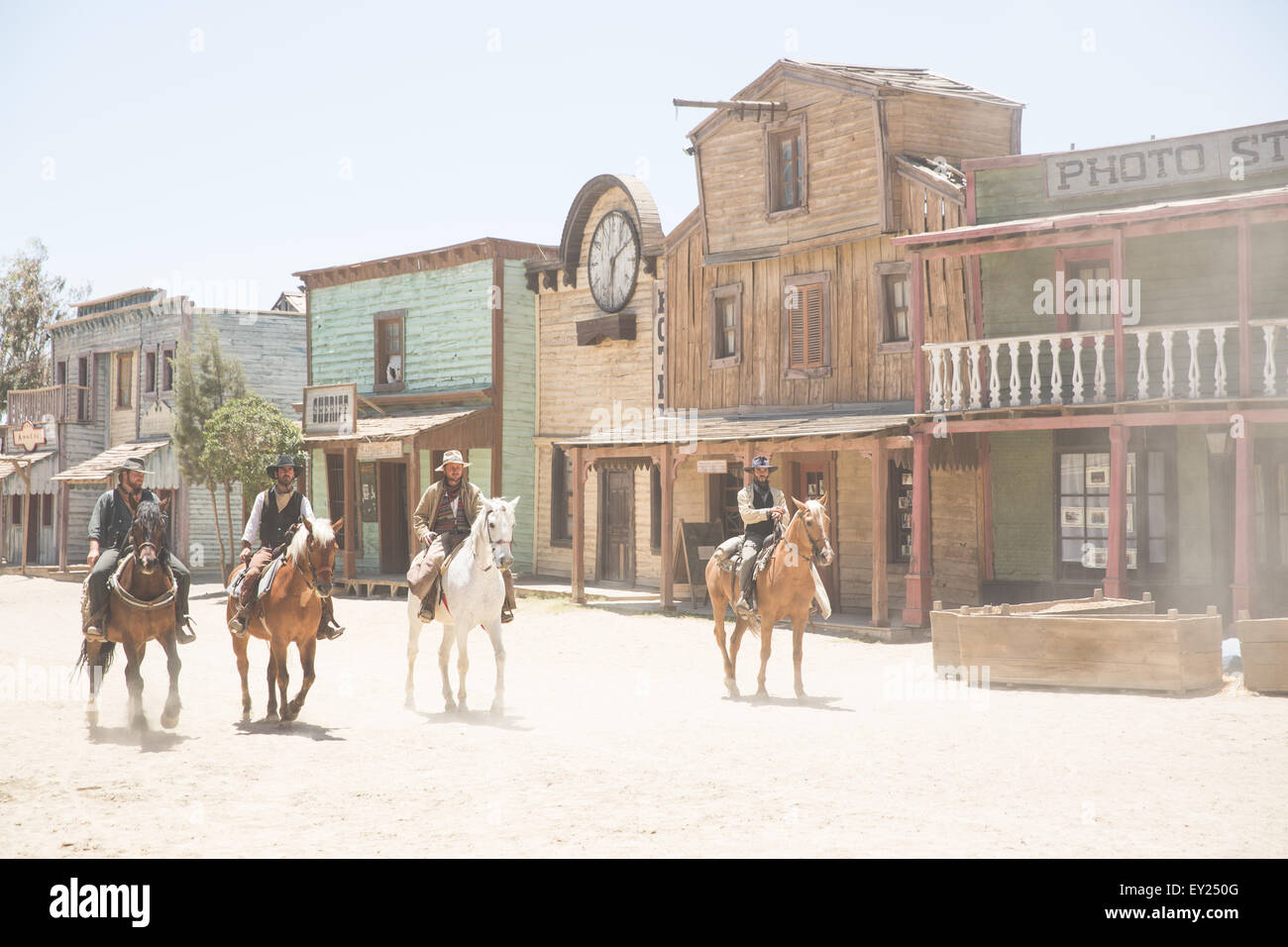 Gang of cowboys riding horses on wild west film set, Fort Bravo, Tabernas, Almeria, Spain - Stock Image