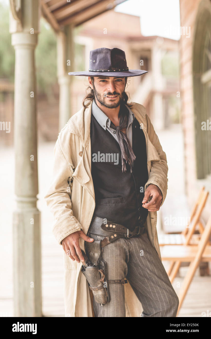 Portrait of cowboy on porch on wild west film set, Fort Bravo, Tabernas, Almeria, Spain - Stock Image