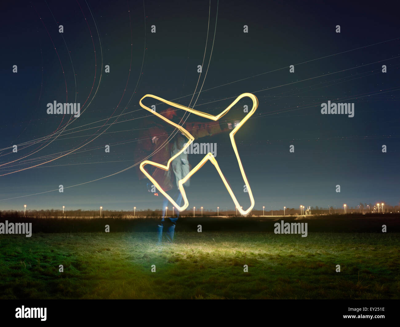 Flight path light trails and glowing airplane symbol at night, Heathrow Airport, London, UK - Stock Image