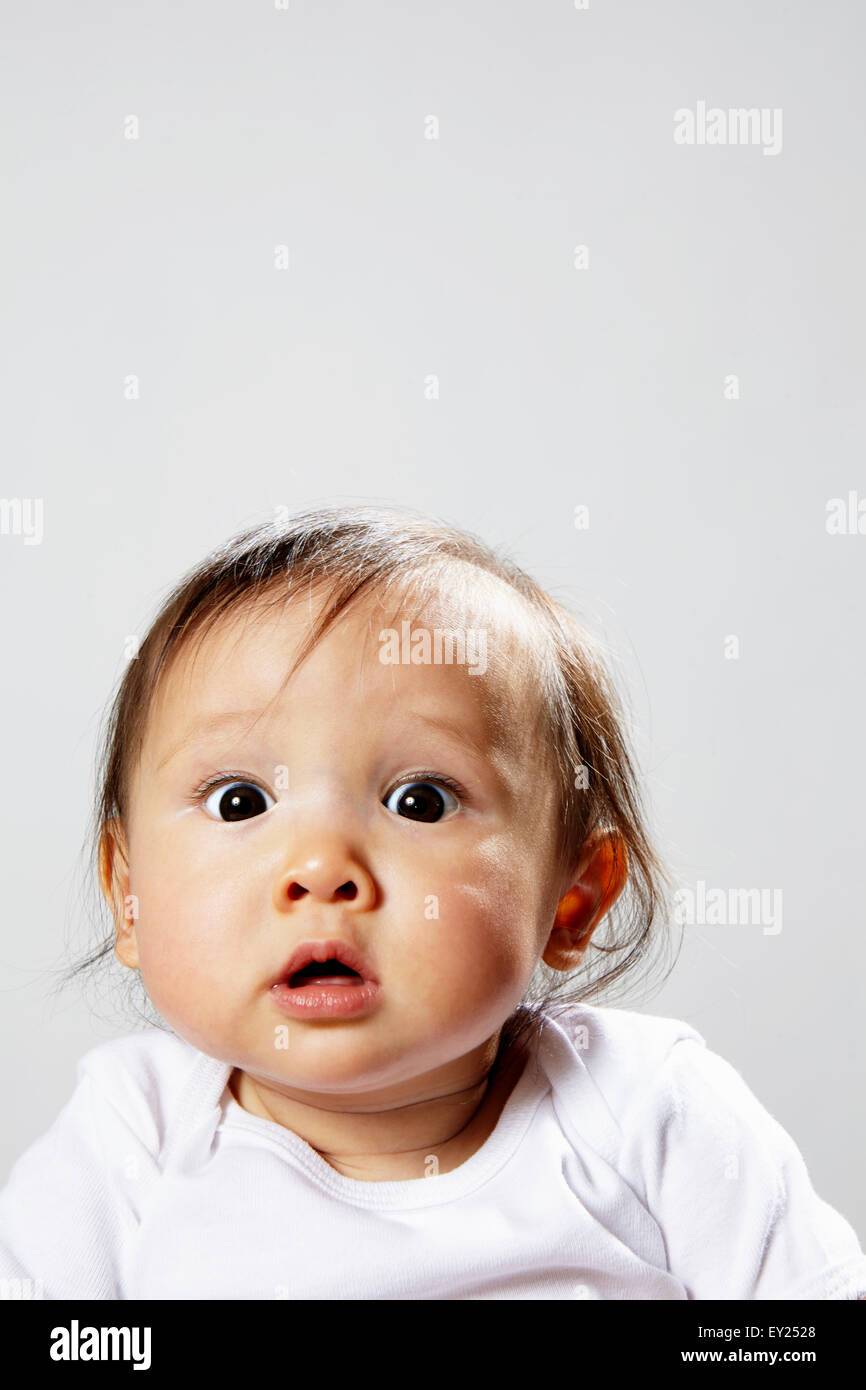 Portrait of baby girl looking surprised - Stock Image