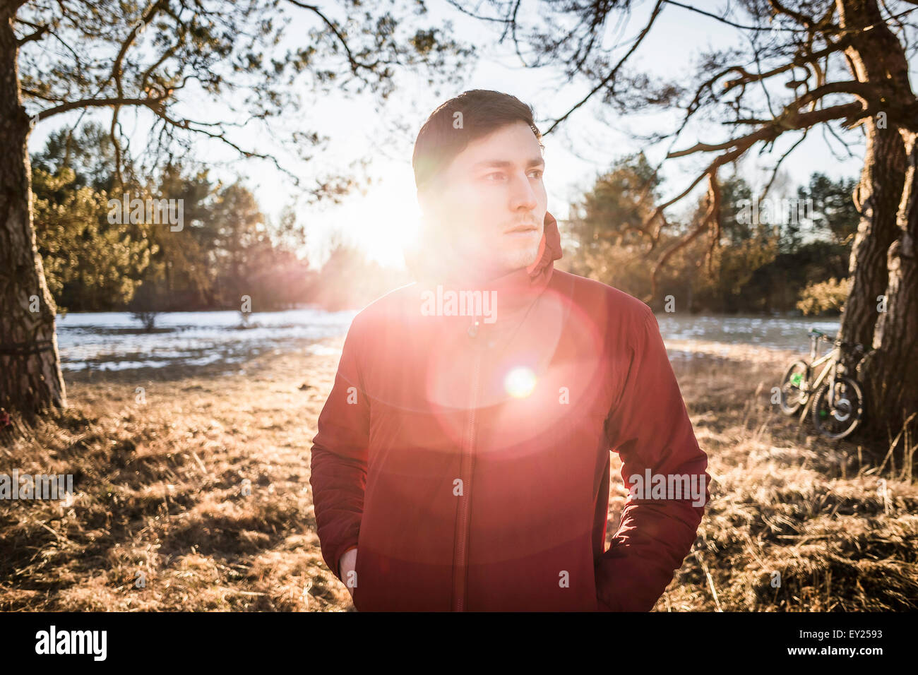Portrait of young male hiker in lakeside forest - Stock Image