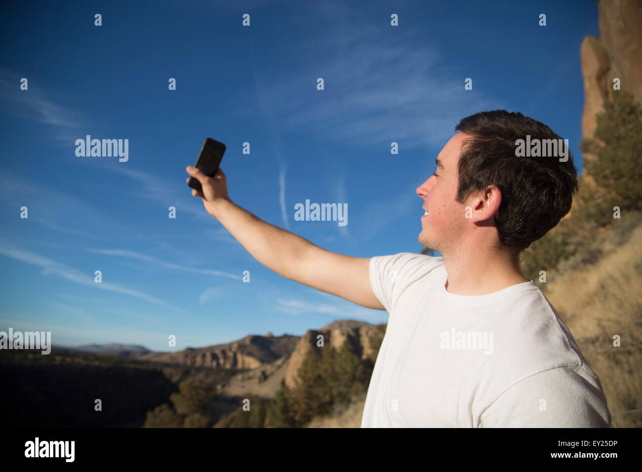 Hiker taking selfie, Smith Rock State Park, Oregon, US - Stock Image