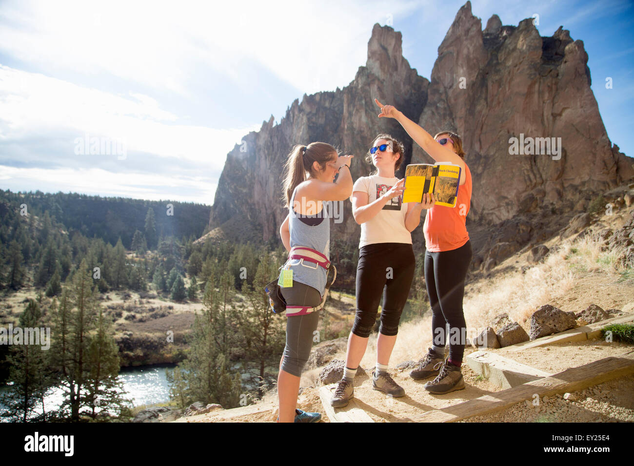 Hikers looking at view, Smith Rock State Park, Oregon, US - Stock Image