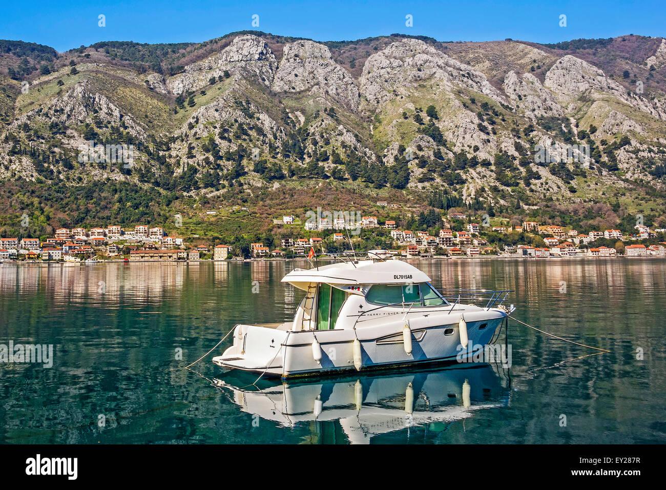Boat Anchored Offshore Kotor Montenegro - Stock Image