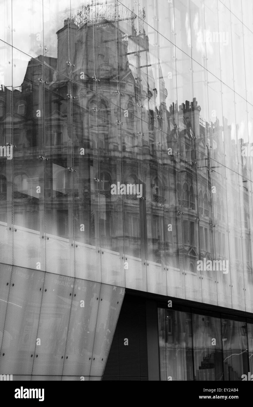 Reflections in a modern building in Wardour Street, London, England. - Stock Image