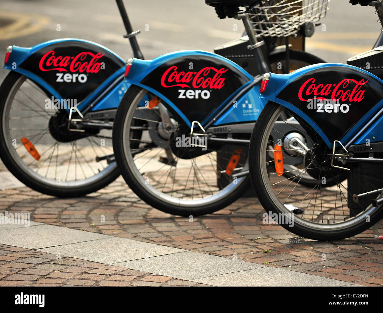 Dublin bicycles with Coco Cola sponsorship on them. - Stock Image