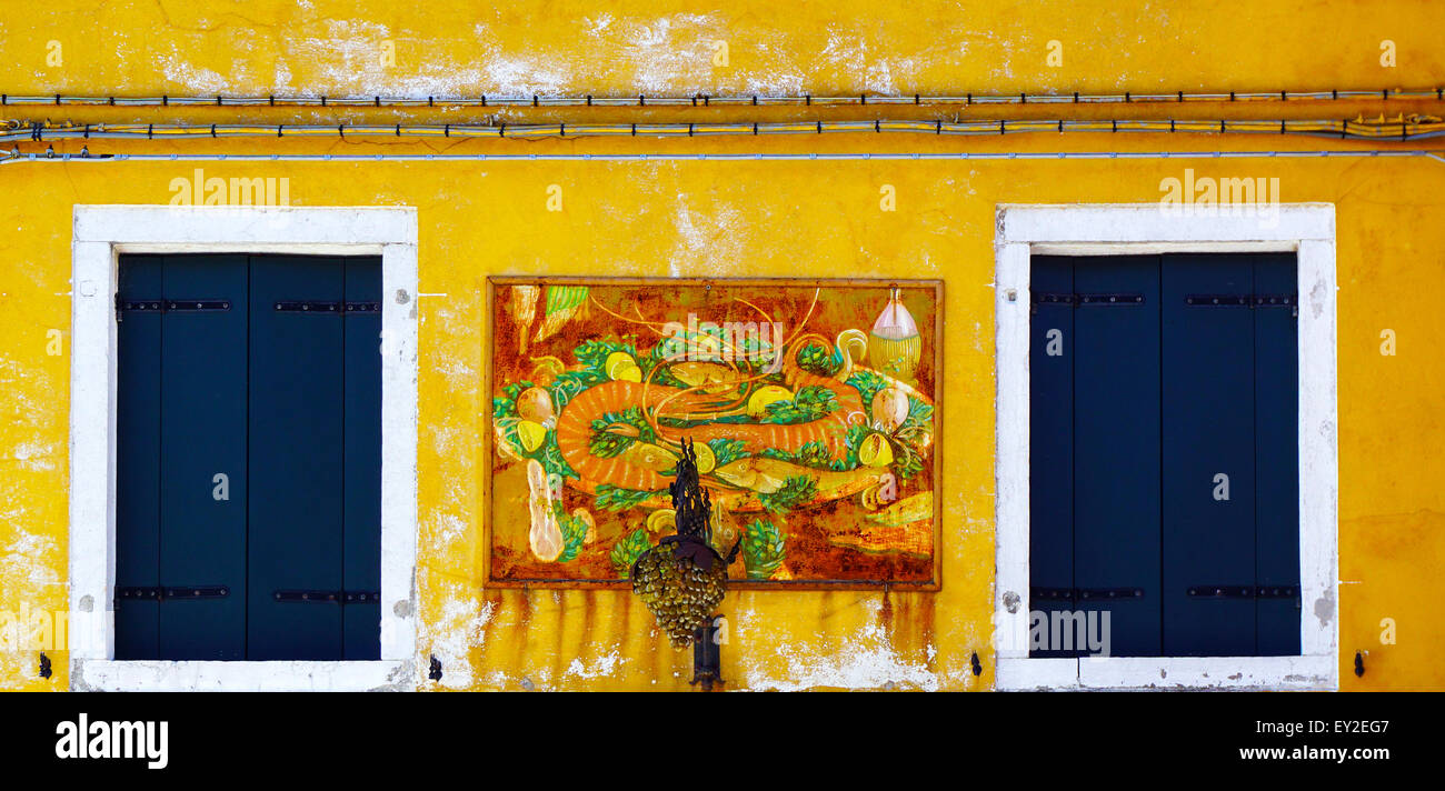Two Windows with white frame in Burano on yellow color decay wall ...