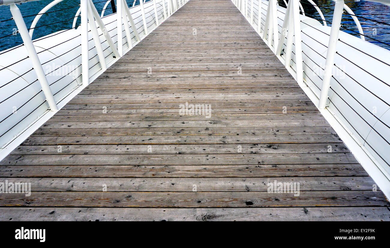 Wooden floor bridge and white railing over Danube river Stock Photo