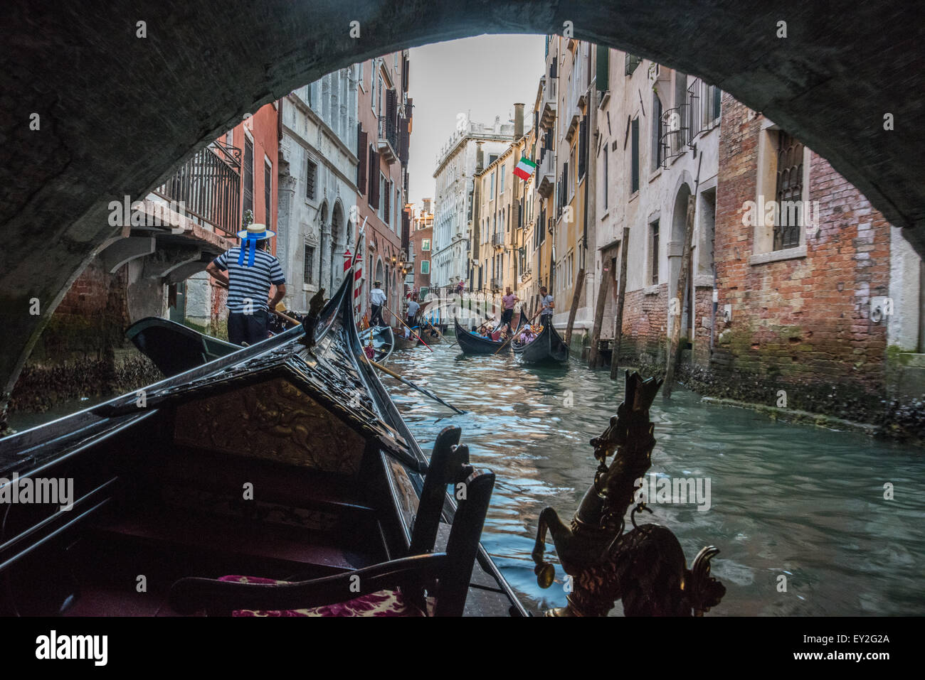 Gondolas Venice Italy on the canal going under a bridge with other gondolas in picture  May 17th 2015 Italy Stock Photo