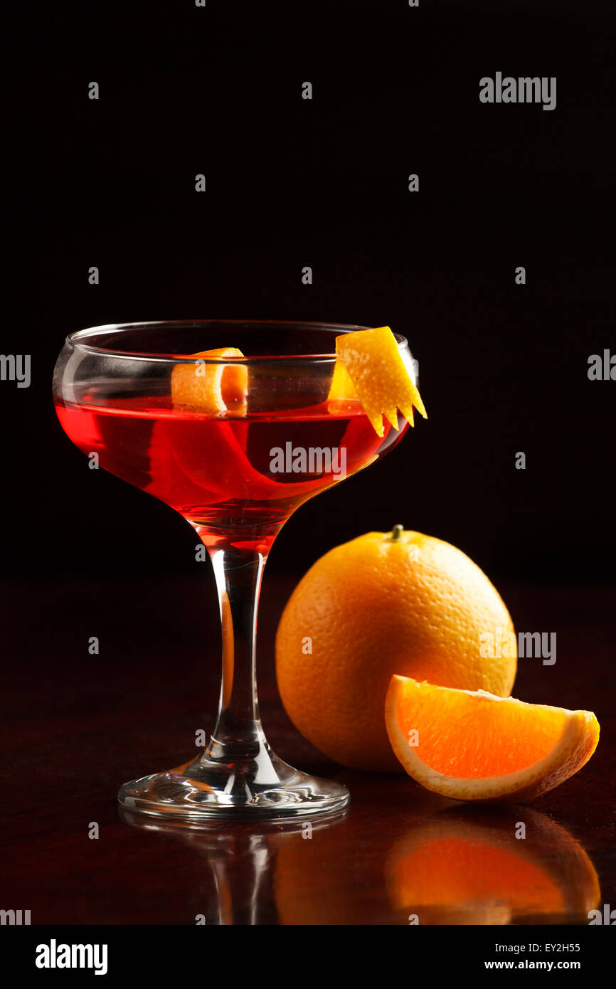 close up of a Cosmopolitan cocktail with black garnish - Stock Image