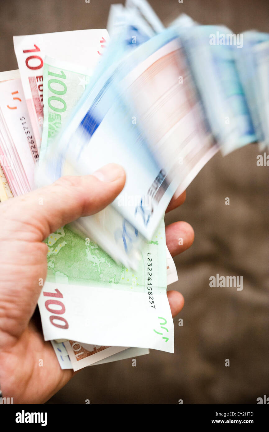 Various Euro Banknotes Blurred By Motion As They Slip Away Out