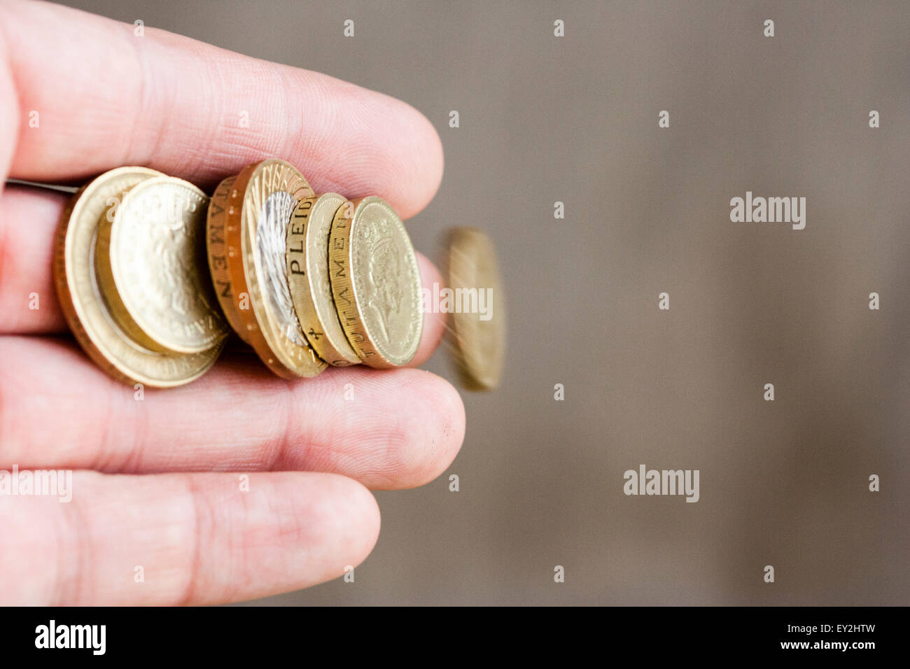 British Pound Coins Blurred By Motion As They Slip Away Out Of