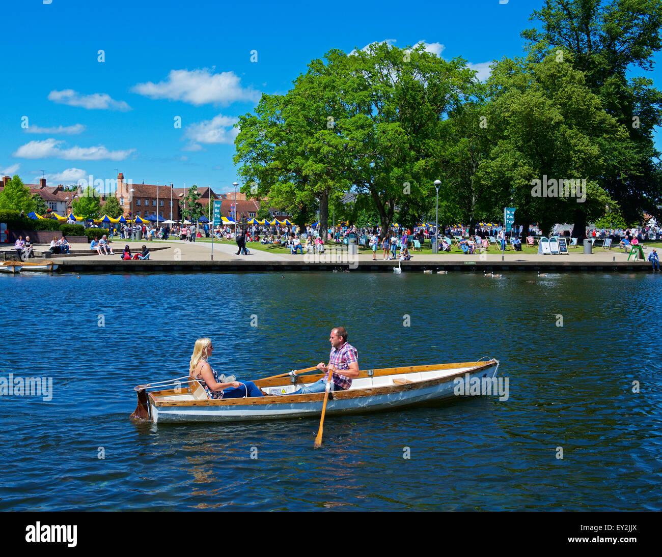 Couple in rowing boat on River Avon, Stratford upon Avon, Warwickshire, England UK - Stock Image