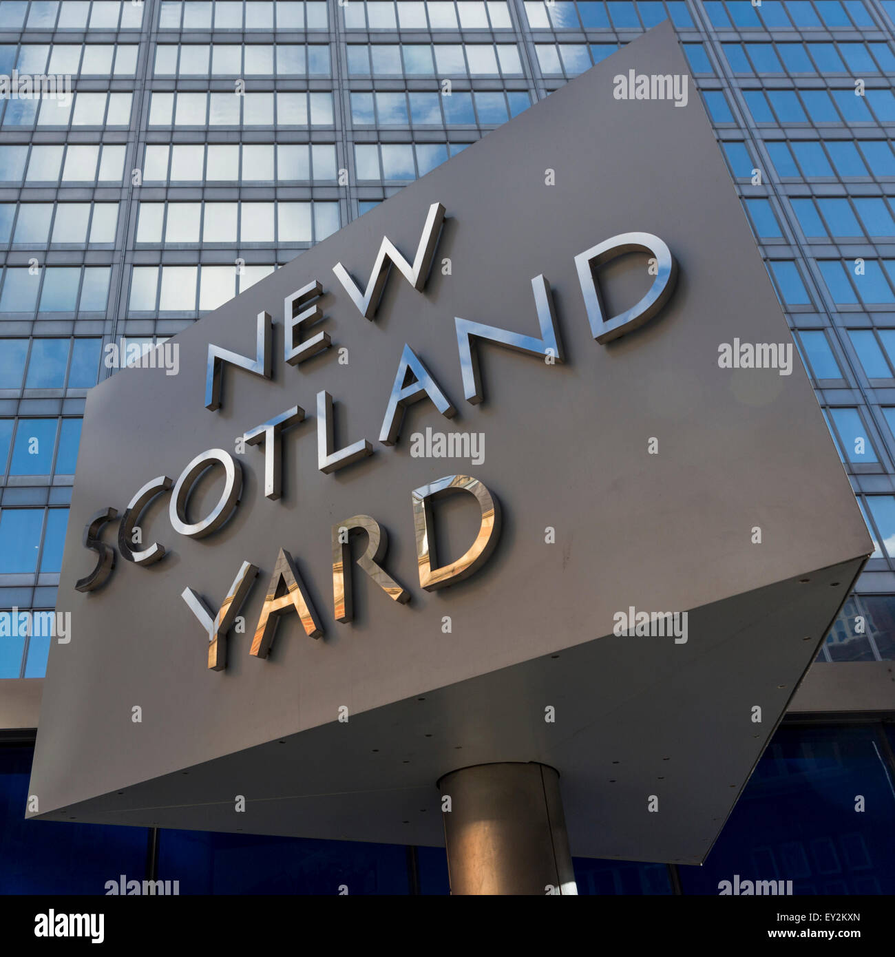 Rotating New Scotland Yard sign in front of police headquarters, London, UK, England - Stock Image